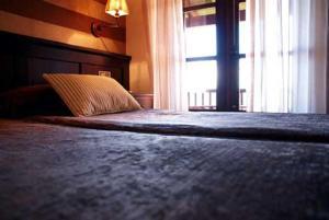 Cama o camas de una habitación en Hostal Meson Leira Antiga