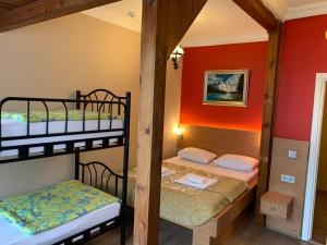 A bed or beds in a room at Antique Hostel