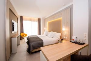 Un ou plusieurs lits dans un hébergement de l'établissement Bahia Principe Fantasia Tenerife