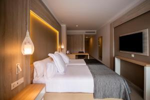 Letto o letti in una camera di Bahia Principe Fantasia Tenerife
