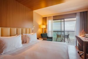 Cama ou camas em um quarto em Laghetto Stilo Barra Rio