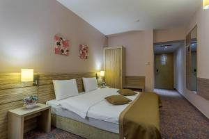 A bed or beds in a room at RIN Grand Hotel