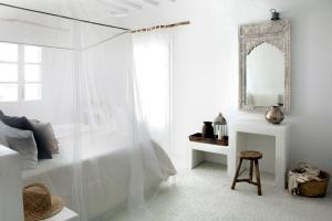 A bed or beds in a room at Soho Roc House Mykonos