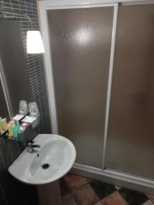 A bathroom at Hotel Montearoma