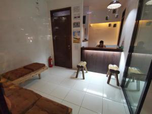 The lobby or reception area at One Hostel - El Nido