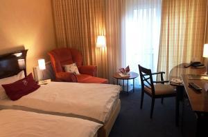 Кровать или кровати в номере Akzent Hotel Höltje