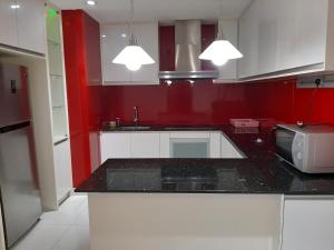 A kitchen or kitchenette at Empire Suite at Time Square