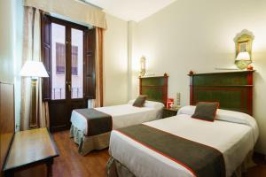 Cama o camas de una habitación en Hotel Plaza Nueva