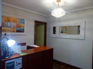 The lobby or reception area at Hostal Álvarez