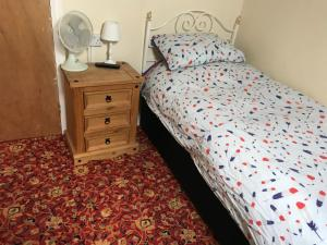 A bed or beds in a room at Bayside Guest House
