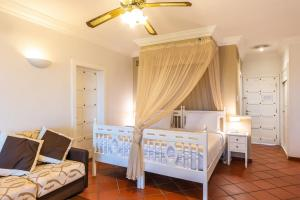 A bed or beds in a room at Hotel La Gemma dell'Est - All Inclusive