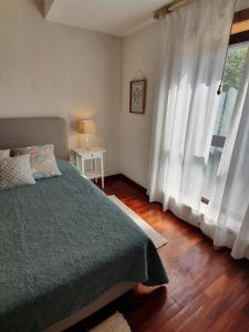 A bed or beds in a room at Apartment Afonso Henriques