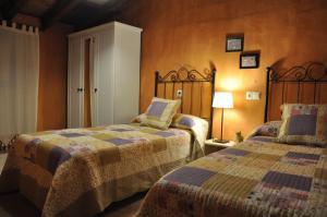 Cama o camas de una habitación en Casa rural La Piedrapipa