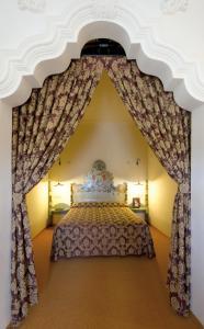 Cama o camas de una habitación en Hostal Palouet de Segarra