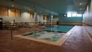 The swimming pool at or near Candlewood Suites-West Springfield, an IHG Hotel