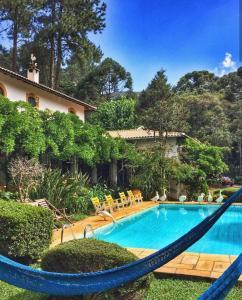 The swimming pool at or near Pousada Villa D'Amore