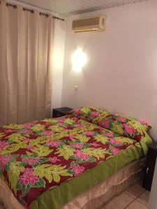 Cama ou camas em um quarto em Fare HereNui