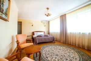 A bed or beds in a room at Hotel Krasnoyarsk