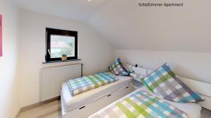 Ein Bett oder Betten in einem Zimmer der Unterkunft Apartments Mosbach