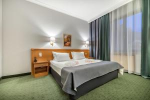 Кровать или кровати в номере Suleiman Palace Hotel