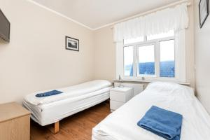 A bed or beds in a room at Mjoeyri Travel Holiday Homes