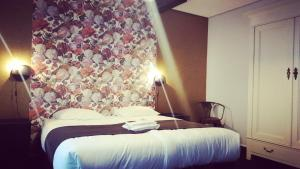 A bed or beds in a room at Hotel Zilt