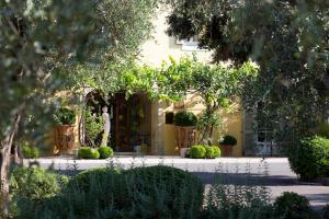 A garden outside Bastide Saint Antoine - Relais & Châteaux