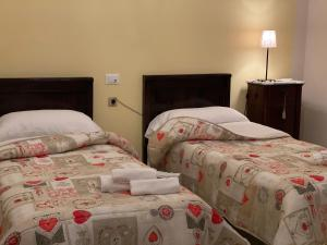 A bed or beds in a room at VILLA PASTORE Salerno