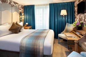 Een bed of bedden in een kamer bij La Maison Favart