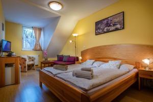 Postel nebo postele na pokoji v ubytování Penzión Harmony