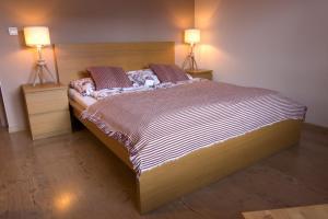 Posteľ alebo postele v izbe v ubytovaní Apartmány Malý Princ