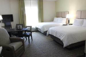 A bed or beds in a room at Candlewood Suites Valdosta Mall, an IHG Hotel