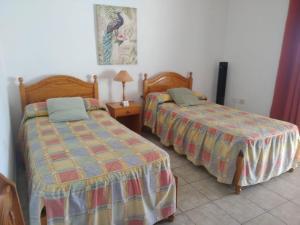 Cama o camas de una habitación en Casitas Rosheli
