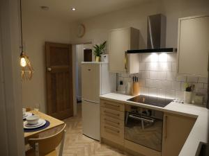 A kitchen or kitchenette at No.8 Newcastle