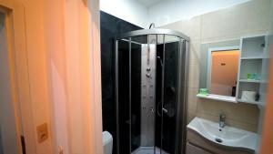 Een badkamer bij Hotel Flox