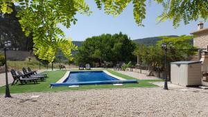 The swimming pool at or near Apartamentos rurales La Alquería del Pilar