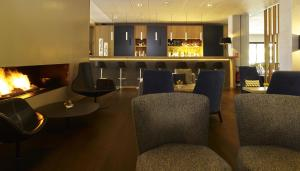 The lounge or bar area at Holiday Inn Express Toulouse Airport, an IHG Hotel