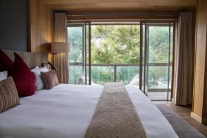 A bed or beds in a room at Menlyn Boutique Hotel