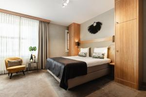 A bed or beds in a room at The Delphi - Amsterdam Townhouse