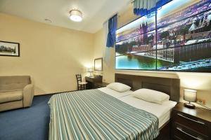 Кровать или кровати в номере HELIOPARK Cruise