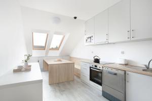 Kuchnia lub aneks kuchenny w obiekcie Apartamenty Góra