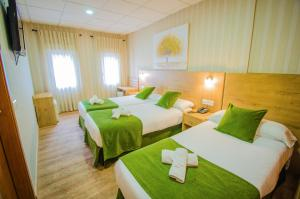 A bed or beds in a room at Hotel Solymar