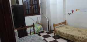 A bed or beds in a room at Aswan Cozy Apartment
