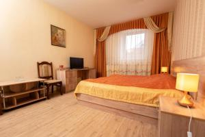 A bed or beds in a room at Prince Vladimir