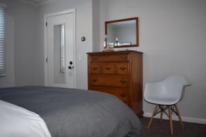 A bed or beds in a room at The Little River Inn