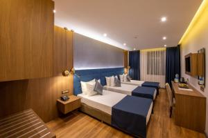 A bed or beds in a room at Nova Plaza Crystal Hotel