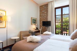 Łóżko lub łóżka w pokoju w obiekcie Gran Hotel Soller