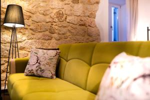 A seating area at Hotel Heritage Forza