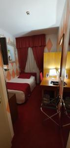A bed or beds in a room at Hotel La Gradisca