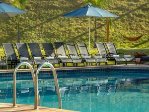 A piscina localizada em Vinhedo Plaza Hotel ou nos arredores